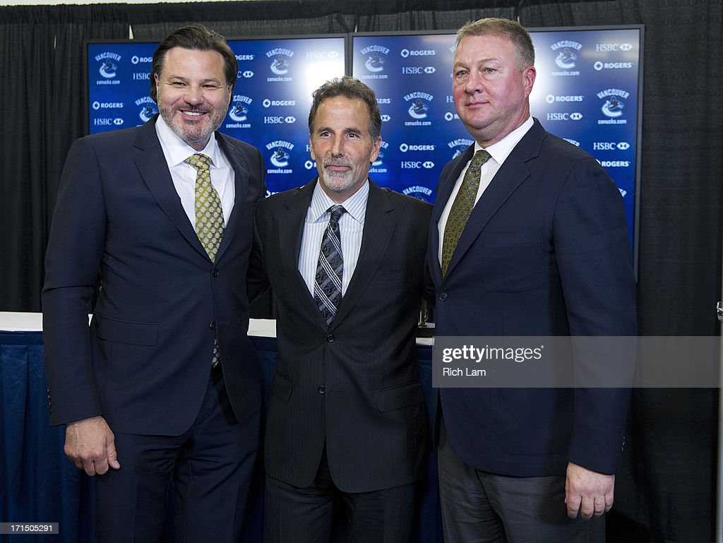 Vancouver Canucks head coach John Tortorella poses for a photo with General Manager Mike Gillis and team owner Francesco Aquilini after a press conference announcing him as the new head coach of the team, June 25, 2013 at Rogers Arena in Vancouver, British Columbia, Canada.