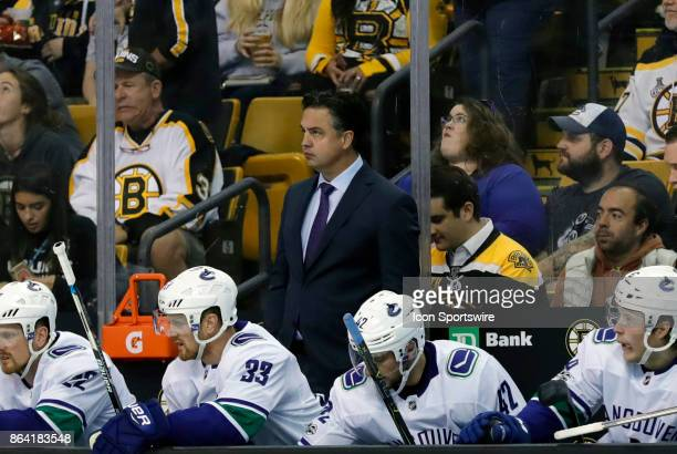 Vancouver Canucks Head Coach Travis Green checks the clock during a game between the Boston Bruins and the Vancouver Canucks on October 19 at TD...