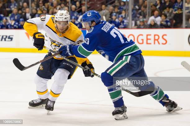 Vancouver Canucks Left wing Antoine Roussel defends against Nashville Predators Left Wing Miikka Salomaki during their NHL game at Rogers Arena on...