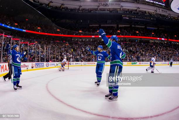 Vancouver Canucks Left Wing Brendan Leipsic celebrates his game winning overtime goal with Center Brandon Sutter and Cefenseman Michael Del Zotto...