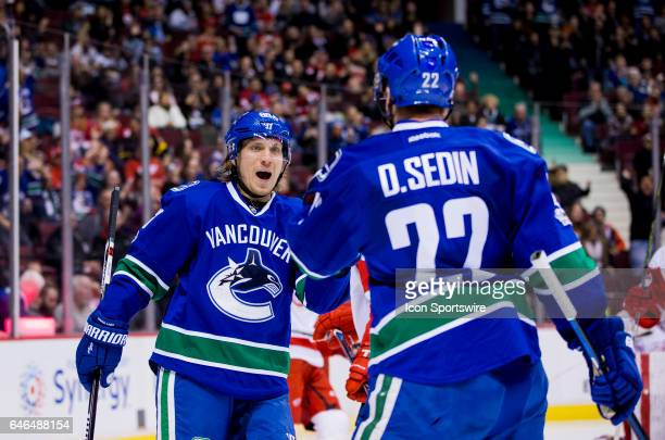 Vancouver Canucks Left Wing Daniel Sedin and Center Markus Granlund celebrate Granlund's second period goal against the Detroit Red WIngs during a...
