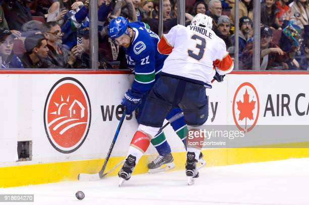 Vancouver Canucks Left Wing Daniel Sedin is checked by Florida Panthers Defenceman Keith Yandle during their NHL game at Rogers Arena on February 14...