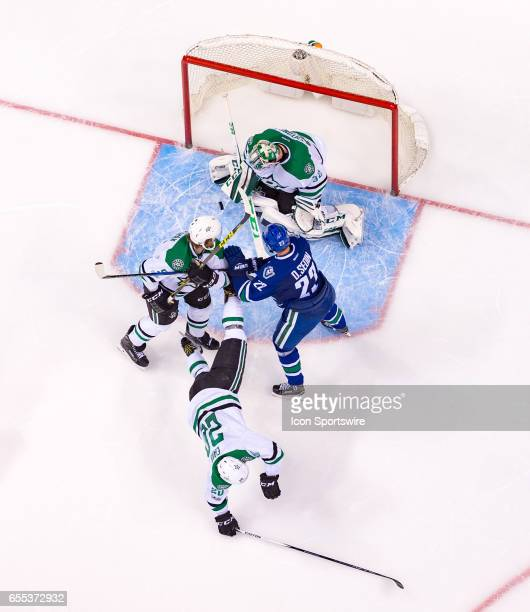 Vancouver Canucks Left Wing Daniel Sedin looks for the rebound as Goalie Kari Lehtonen Defenceman Jamie Oleksiak and Dallas Stars Center Cody Eakin...