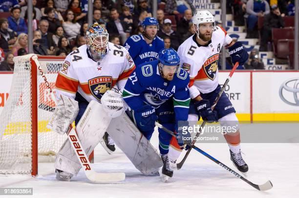 Vancouver Canucks Left Wing Daniel Sedin stands in front of Goalie James Reimer as Florida Panthers Defenceman Aaron Ekblad defends during their NHL...