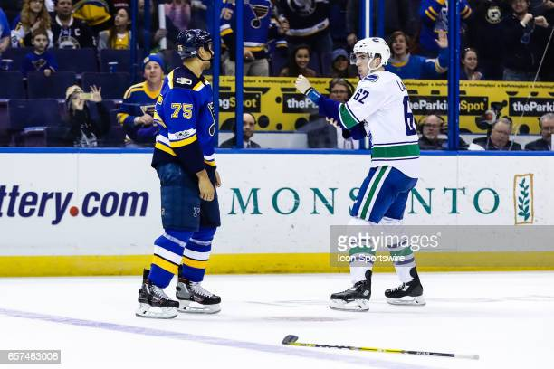 Vancouver Canucks Left Wing Joseph Labate and St. Louis Blues Right Wing Ryan Reaves square off near center ice during the third period of an NHL...