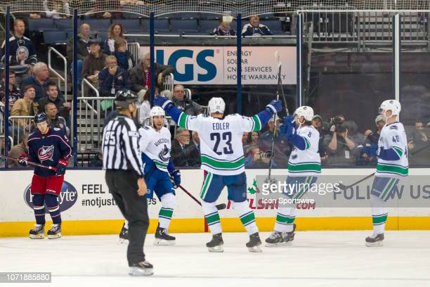 Vancouver Canucks left wing Josh Leivo celebrates after scoring a goal in a game between the Columbus Blue Jackets and the Vancouver Canucks on...