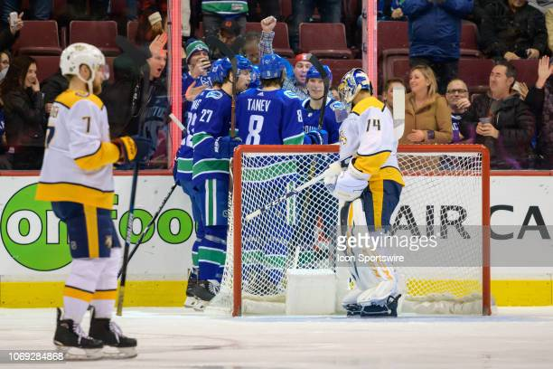 Vancouver Canucks Left wing Loui Eriksson is congratulated after scoring a goal on Nashville Predators Goalie Juuse Saros during their NHL game at...