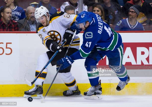 Vancouver Canucks Left Wing Sven Baertschi attempts to check Boston Bruins Defenceman Kevan Miller during a NHL hockey game on March 13 at Rogers...