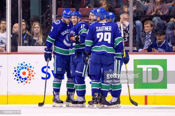 Vancouver Canucks left wing Sven Baertschi is congratulated after scoring a goal during their NHL preseason game against the Edmonton Oilers at...