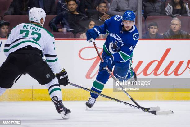 Vancouver Canucks Left Wing Sven Baertschi shoots on Dallas Stars Defenceman Marc Methot in a NHL hockey game on October 30 at Rogers Arena in...