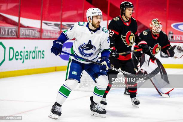 Vancouver Canucks Left Wing Tyler Motte keeps eyes on the play defended by Ottawa Senators Defenceman Nikita Zaitsev during first period National...