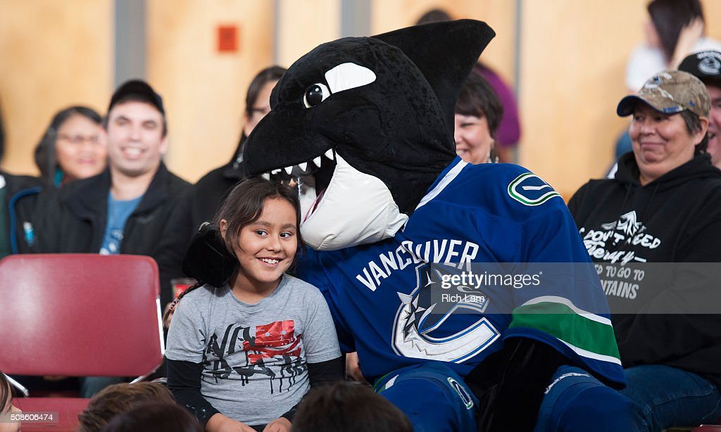 Vancouver Canucks mascot Fin bites the head of James Finney-Jules during a visit to Sk'elep School of Excellence for a visit on Day 2 of 2016 Scotiabank Hockey Day in Canada on February 5, 2016 in Kamloops, British Columbia, Canada.