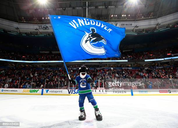 Vancouver Canucks mascot Fin celebrates after their NHL game against the Chicago Blackhawks at Rogers Arena December 28 2017 in Vancouver British...