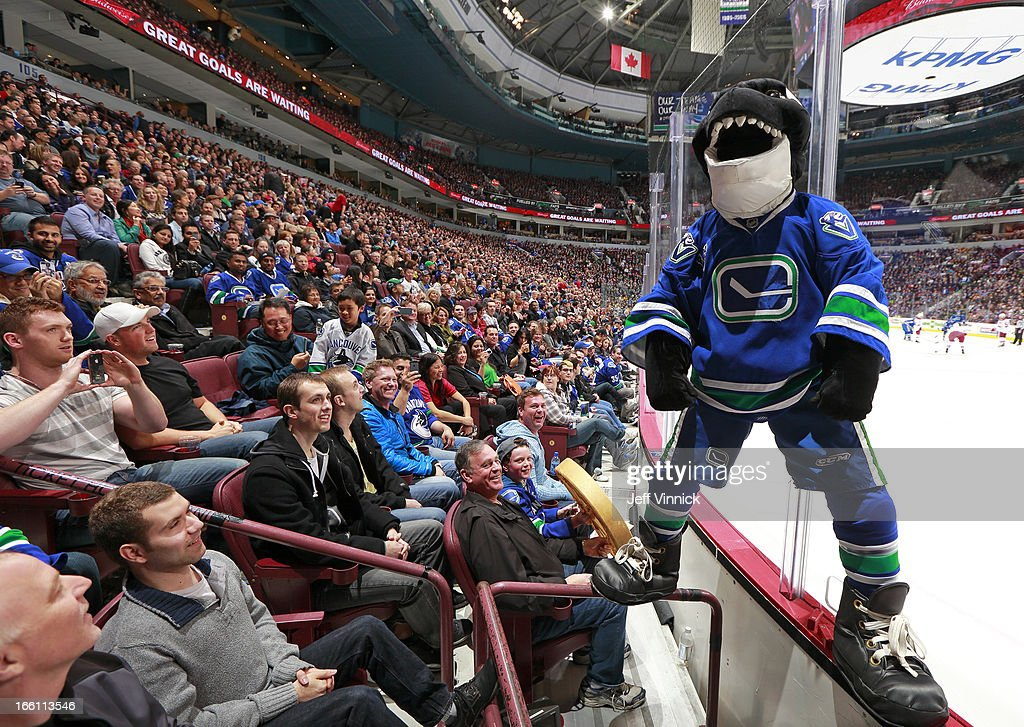 Vancouver Canucks mascot Fin entertains fans during the NHL game between the Vancouver Canucks and the Phoenix Coyotes at Rogers Arena April 8, 2013 in Vancouver, British Columbia, Canada. Vancouver won 2-0.