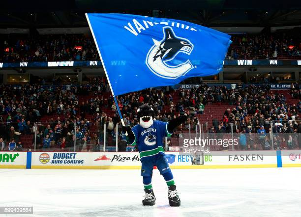 Vancouver Canucks mascot Fin entertains fans during the NHL game against the Carolina Hurricanes at Rogers Arena December 5 2017 in Vancouver British...