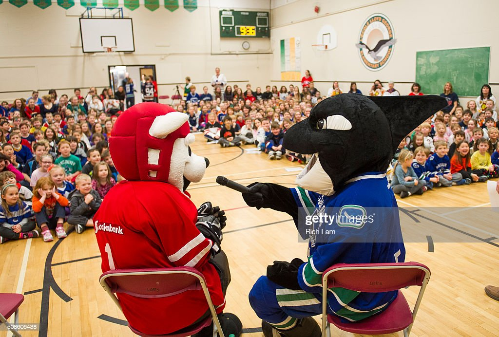 Vancouver Canucks mascot Fin interviews Scotiabank mascot Scoti while visiting Lloyd George Elementary School for on Day 2 of 2016 Scotiabank Hockey Day in Canada on February 5, 2016 in Kamloops, British Columbia, Canada.