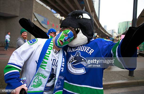 Vancouver Canucks' mascot Fin plays with a fan before Game Five of the Western Conference Quarterfinals during the 2015 NHL Stanley Cup Playoffs at...