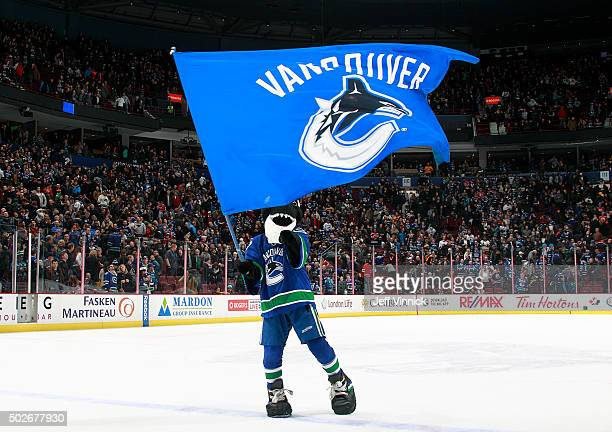 Vancouver Canucks mascot Fin waves a flag during the NHL game between the Edmonton Oilers and the Vancouver Canucks at Rogers Arena December 26 2015...