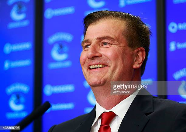 Vancouver Canucks new General Manager smiles during a press conference at Rogers Arena May 23 2014 in Vancouver British Columbia Canada