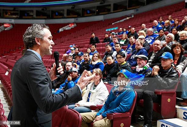 Vancouver Canucks' President Trevor Linden addresses seasonticket holders before their NHL game against the Calgary Flames at Rogers Arena December...