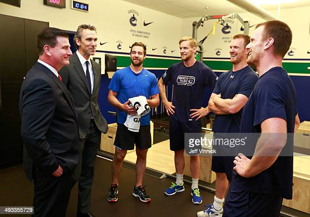 Vancouver Canucks President Trevor Linden introduces new General Manager Jim Benning to players Chris Higgins Alexander Edler Henrik Sedin and Daniel...