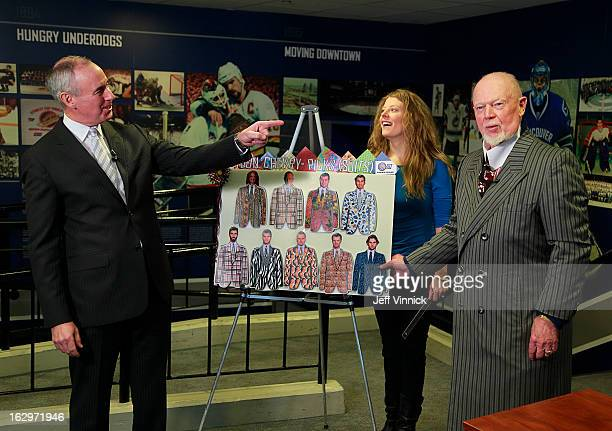 Vancouver Canucks reporter Kathy Anderson laughs as CBC commentator Ron MacLean points at Don Cherry as he puts a magnetic suit on Zack Kassian of...