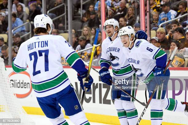 Vancouver Canucks Right Wing Brock Boeser celebrates his goal with teammates during the first period in the NHL game between the Pittsburgh Penguins...