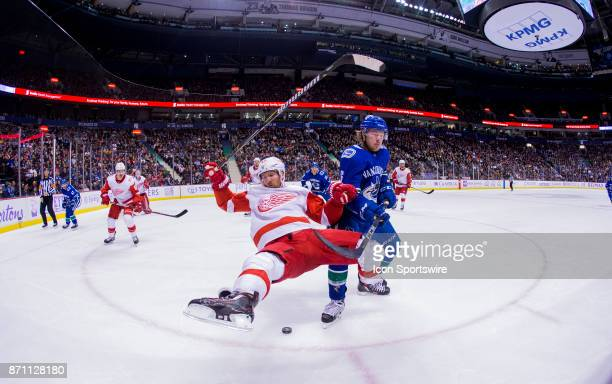 Vancouver Canucks Right Wing Brock Boeser trips up Detroit Red Wings Winger Darren Helm in a NHL hockey game on November 06 at Rogers Arena in...