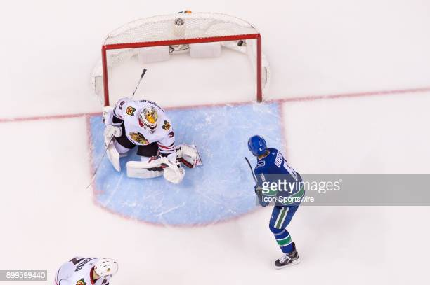 Vancouver Canucks Right Wing Brock Boeser watches a goal by Winger Sam Gagner on Chicago Blackhawks Goalie Anton Forsberg during their NHL game at...