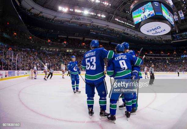 Vancouver Canucks Right Wing Jake Virtanen and Center Bo Horvat and Left Wing Brendan Leipsic and Cefenseman Alexander Edler celebrate Leipsic's goal...