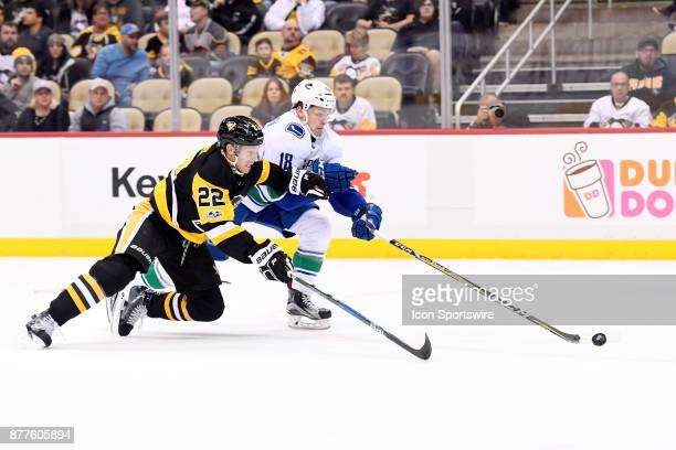 Vancouver Canucks Right Wing Jake Virtanen and Pittsburgh Penguins Defenseman Matt Hunwick go for the puck during the first period in the NHL game...