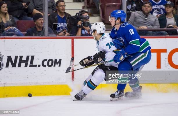 Vancouver Canucks Right Wing Jake Virtanen checks San Jose Sharks Defenseman Dylan DeMelo during the second period in a NHL hockey game on March 17...