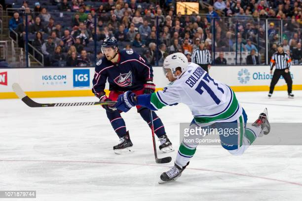 Vancouver Canucks right wing Nikolay Goldobin attempts a shot on goal in a game between the Columbus Blue Jackets and the Vancouver Canucks on...
