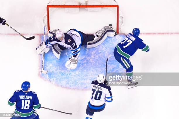 Vancouver Canucks right wing Nikolay Goldobin scores a goal on Winnipeg Jets goalie Connor Hellebuyck during their NHL game at Rogers Arena on...