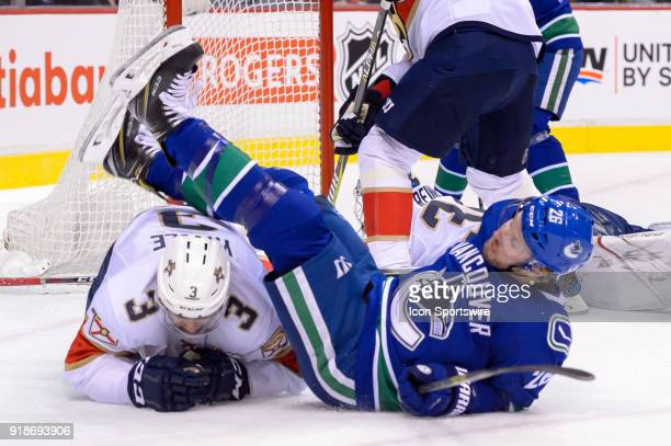 Vancouver Canucks Right Wing Thomas Vanek falls over top of Florida Panthers Defenceman Keith Yandle during their NHL game at Rogers Arena on...