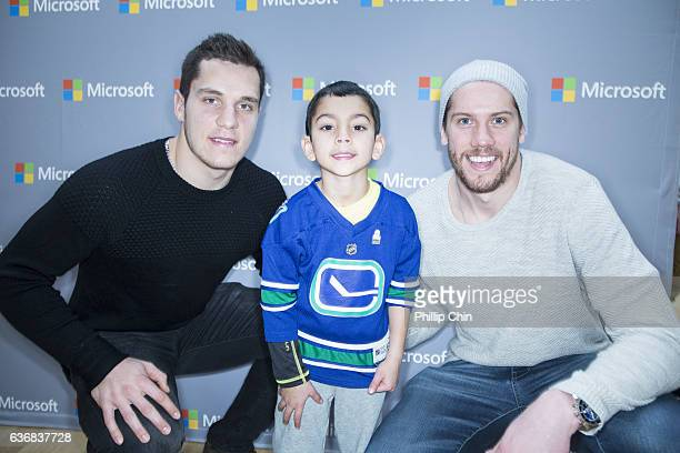 Vancouver Canucks stars Bo Horvat and Jacob Markstrom celebrate NHL 17 with their fans at the Microsoft Store at Pacific Centre on December 17 2016...