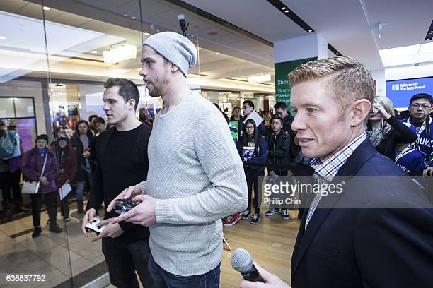 Vancouver Canucks stars Bo Horvat Jacob Markstrom and announcer Scott Rintoul celebrate NHL 17 with their fans at the Microsoft Store at Pacific...