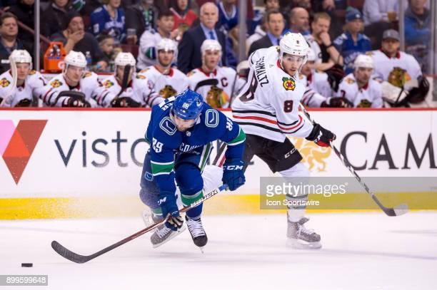 Vancouver Canucks Winger Sam Gagner collides with Chicago Blackhawks Left Wing Nick Schmaltz during their NHL game at Rogers Arena on December 28...