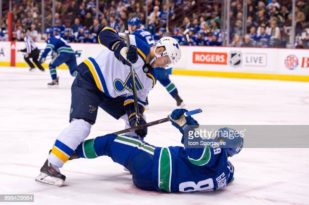Vancouver Canucks Winger Sam Gagner is checked to the ice by St Louis Blues Winger Vladimir Sobotka during their NHL game at Rogers Arena on December...