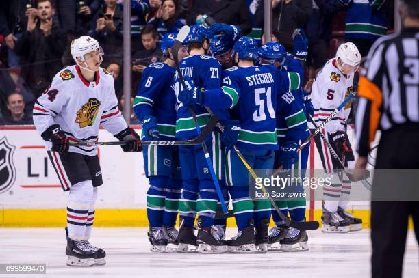 Vancouver Canucks Winger Sam Gagner is congratulated after scoring a goal during their NHL game against the Chicago Blackhawks at Rogers Arena on...
