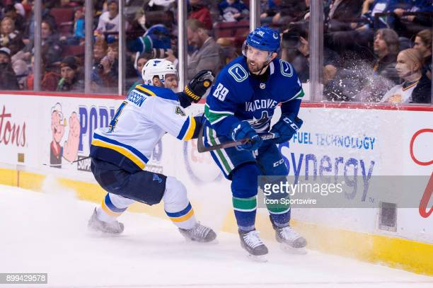 Vancouver Canucks Winger Sam Gagner is pursued by St Louis Blues Defenceman Carl Gunnarsson during their NHL game at Rogers Arena on December 23 2017...