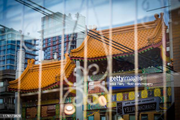 vancouver chinatown reflected - chinatown stock pictures, royalty-free photos & images
