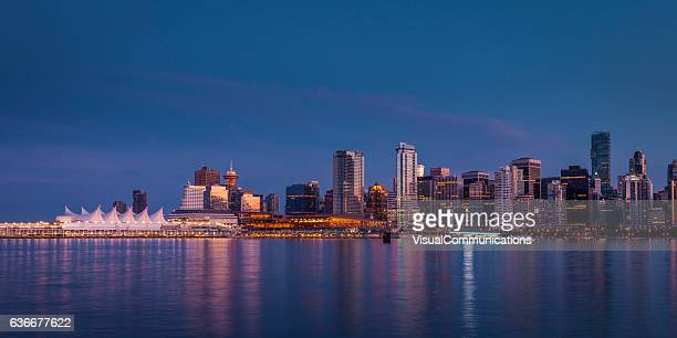 vancouver city skyline after sunset. - vancouver canada stock photos and pictures