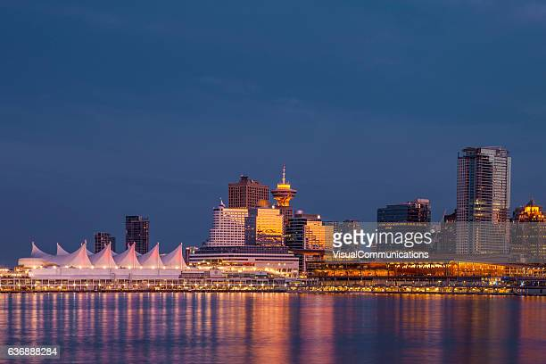 vancouver city skyline after sunset. - vancouver canada stock pictures, royalty-free photos & images
