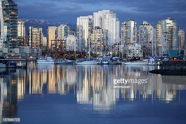 vancouver city skyline reflected in river at night - vancouver canada stock pictures, royalty-free photos & images