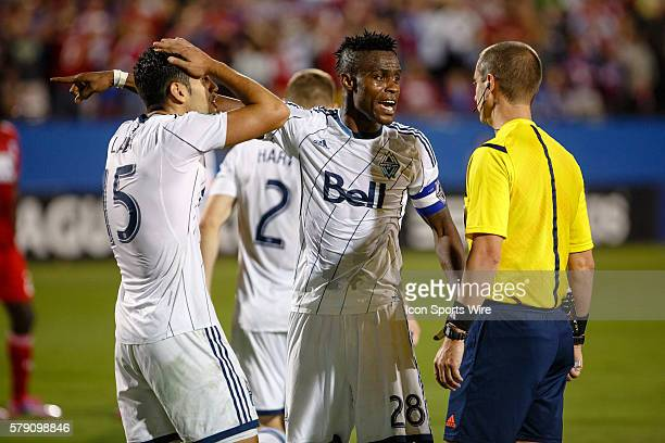 Vancouver FC midfielder Gershon Koffie and midfielder Matias Laba argue with referee Mark Geiger about a hand ball call during the MLS Western...