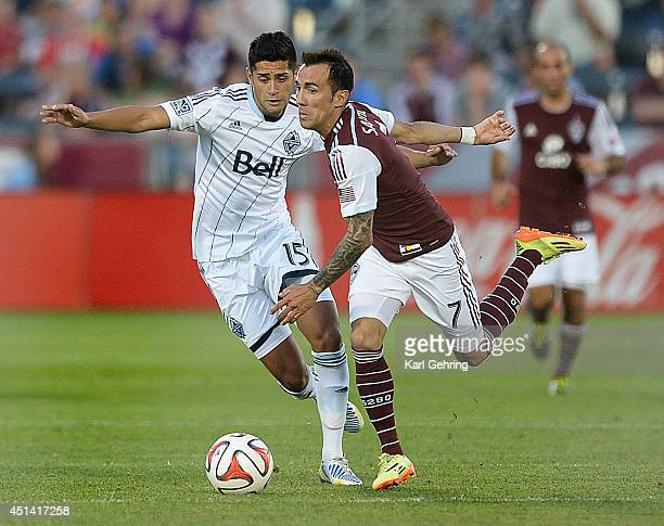 Vancouver midfielder Matias Laba and Colorado forward Vicente Sanchez battled for the ball in the second half The Colorado Rapids defeated the...