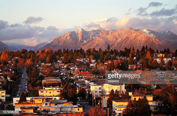 vancouver mountains with snow at sunset - vancouver stock pictures, royalty-free photos & images