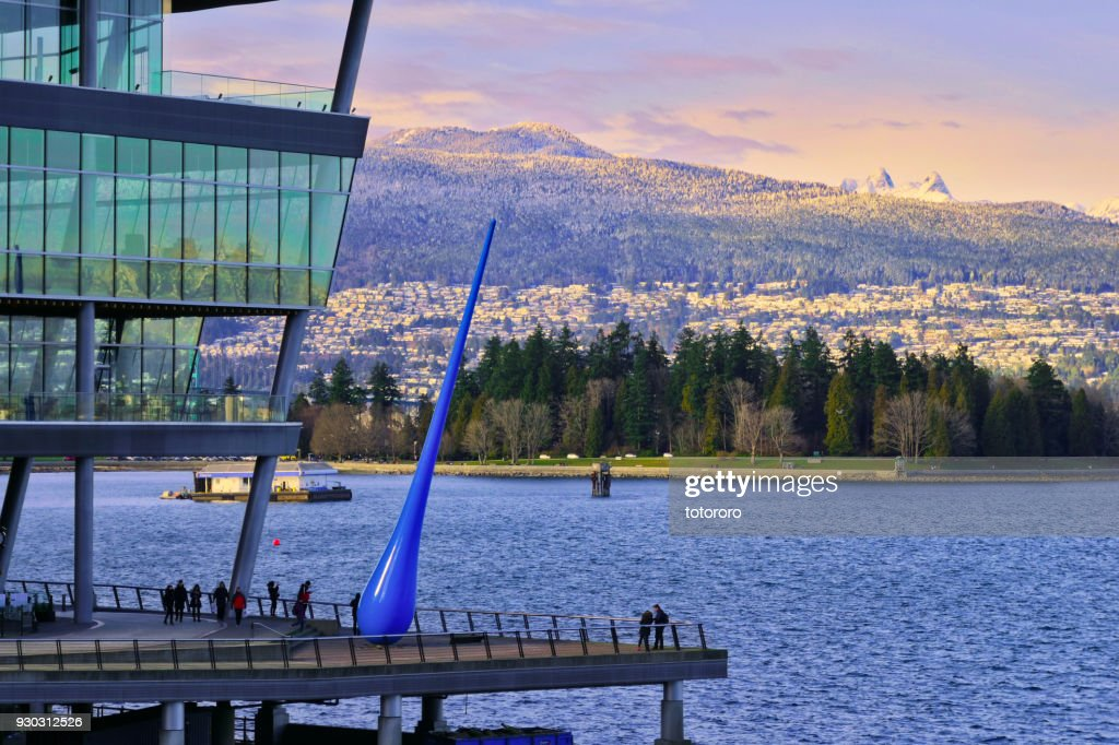 Vancouver North Shore Skyline with Vancouver Convention Centre, Ocean, Stanley Park and Snow Capped Mountains : Stock Photo