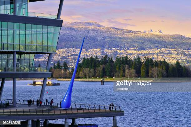 vancouver north shore skyline with vancouver convention centre, ocean, stanley park and snow capped mountains - shoreline amphitheatre mountain view stock photos and pictures